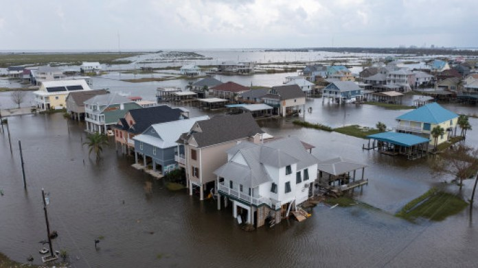 Flood waters still surround homes as residents try to recover from the effects of Hurricane Ida Wednesday.