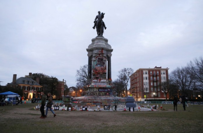 People occupy the space in front of the Robert E. Lee statue in January, 2021.