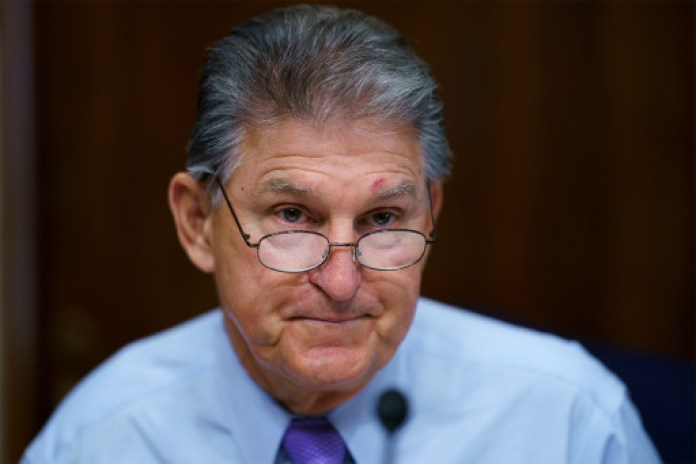 """Manchin asked for Democratic leaders to """"hit the pause button"""" on the spending plan."""