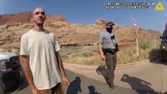 """This police camera video provided by The Moab Police Department shows Brian Laundrie  talking to a police officer after police pulled over the van he was traveling in with his girlfriend, Gabrielle """"Gabby"""" Petito, near the entrance to Arches National Park on Aug. 12, 2021."""