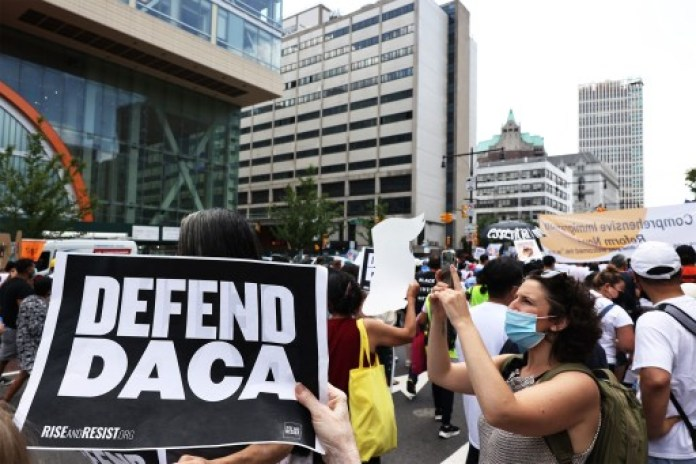 People participate in a march in support of a pathway to citizenship for immigrants on July 23, 2021 in New York City.