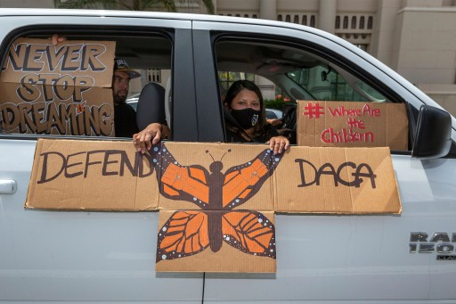 An immigrant family joins members of Coalition for Humane Immigrant Rights of Los Angeles, CHIRLA, on a vehicle caravan rally to support the Deferred Action for Childhood Arrivals.