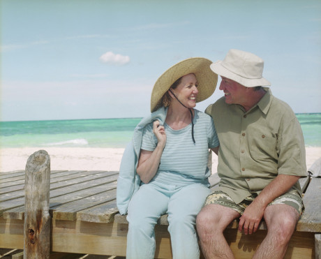 Smiling Couple on Pier at the Beach