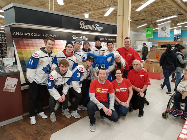 The Penticton Vees volunteer to help kids build birdhouses at Penticton Home Hardware.