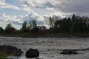 A raging river and a house on the Swedish side