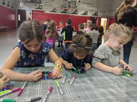 From left: Kindergarten students Emmaline Martinez, Charlie Lima and Rozlyn Sholomith learned about trash and waste, upcycling and sustainability on Tuesday. (Courtesy Photo Pentucket Regional School District)