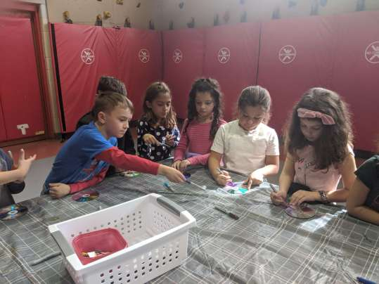 From left: Second grade students Nico Murray, Lila Alexander, Emma Johnson, Grace Singleton and Maggie Artus upcycle CDs during a STEM Week activity. (Courtesy Photo Pentucket Regional School District)
