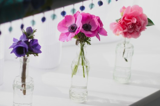 Spring Blooms in Glass Bottles