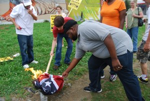 burning confederate flag in Baltimore Rev Witherspoon, Sherelle, David, Steven-1