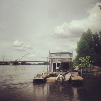 A houseboat moored along the Mississippi River