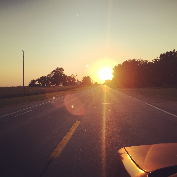 An Iowa highway sunset in Terry's beater car