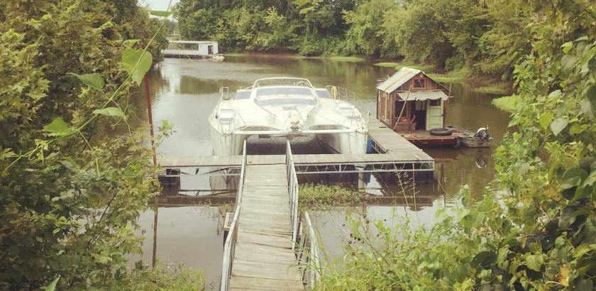 Shantyboat in the secret abandoned marina of the planet of the apes