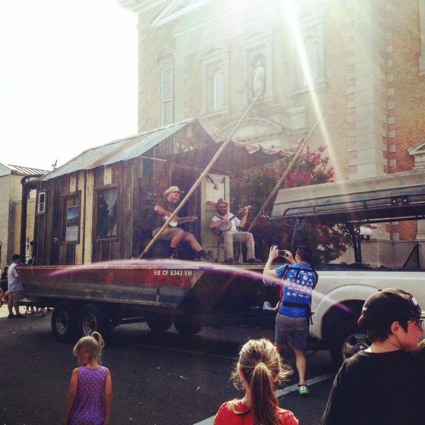 Shantyboat in the Paducah Labor Day Parade. Nathan Lynn playing banjo while Wes tries to make banjo sounds that are not too disharmonious. Photo by Mitch Kimball