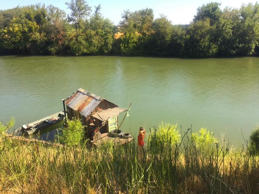 Shantyboat beached along Sutter Slough