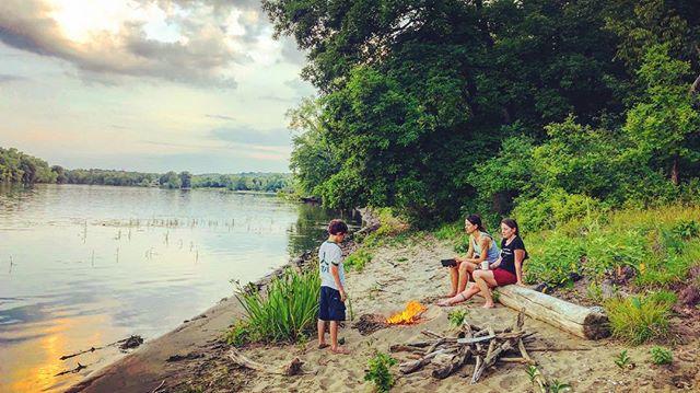 Little beach campfire along the shore of the Hudson River