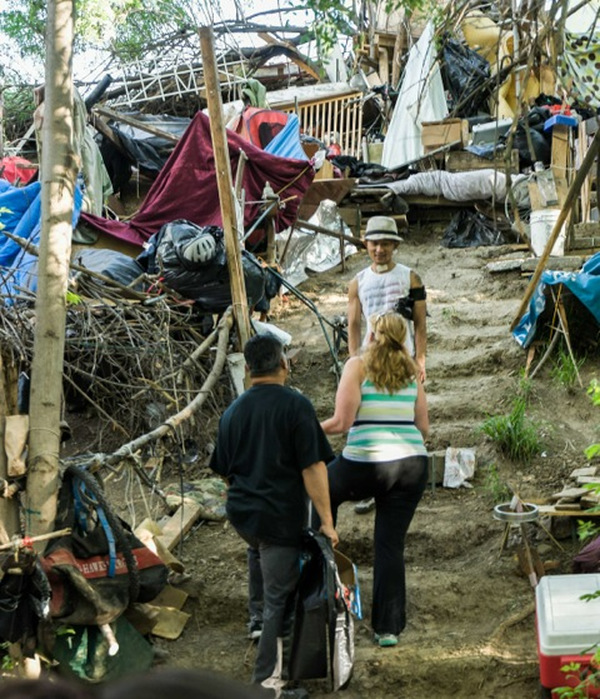 """People in Silicon Valley, home to the billionaire tech giants, work with people who live in the """"Jungle,"""" the largest homeless tent city in the nation, to clean up on Earth Day. PHOTO/SILICON VALLEY DE-BUG"""