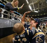 Shaun Hill and his family celebrate beating the Denver Broncos.