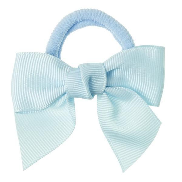 lazo azul claro pelo niña