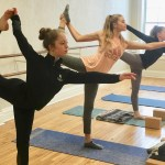 Three women in a yoga class