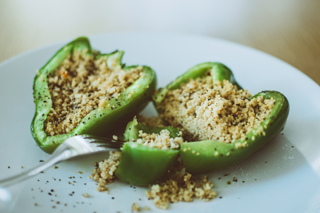 Photo of healing food green bell pepper stuffed with quinoa