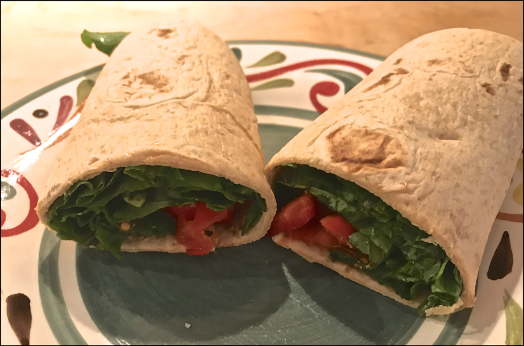 Photo of a spinach wrap as an example healthy lunch options
