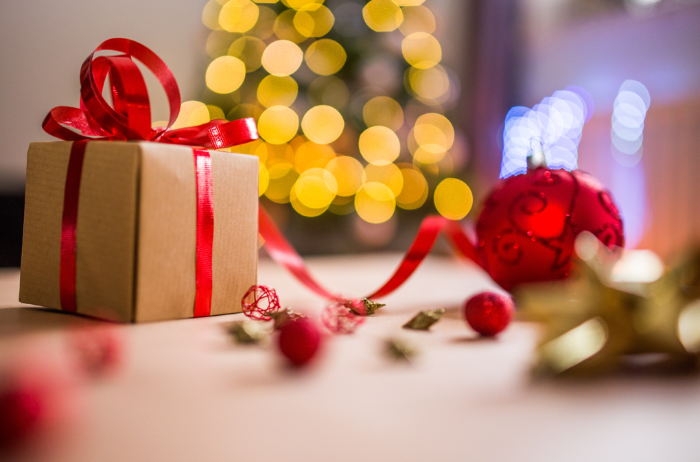 Photo of a wrapped present and red ribbon that symbolizes intentional gift giving