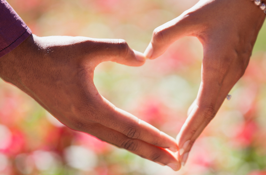 Photo of hands in a heart shape as a symbol for intimate relationships