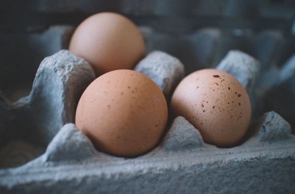 Image of brown eggs sitting in a carton.