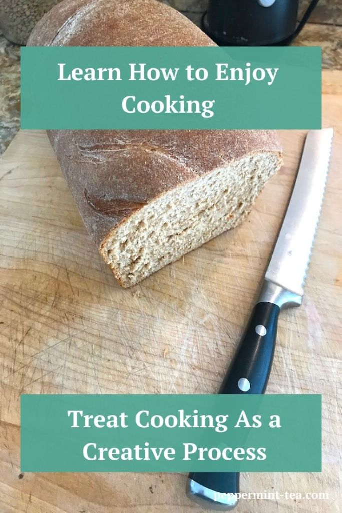 Photo of loaf of homemade whole wheat bread beside bread knife on cutting board