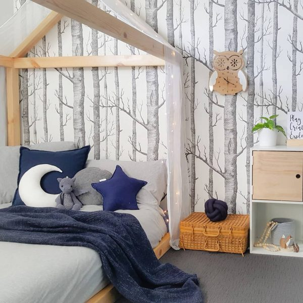 Boys Woodland Bedroom - House Bed, Forest Themed Wallpaper, Navy and Grey Bedlinen, fairy lights draped on bed and Medium White Moon Cushion, Medium Navy Star Cushion