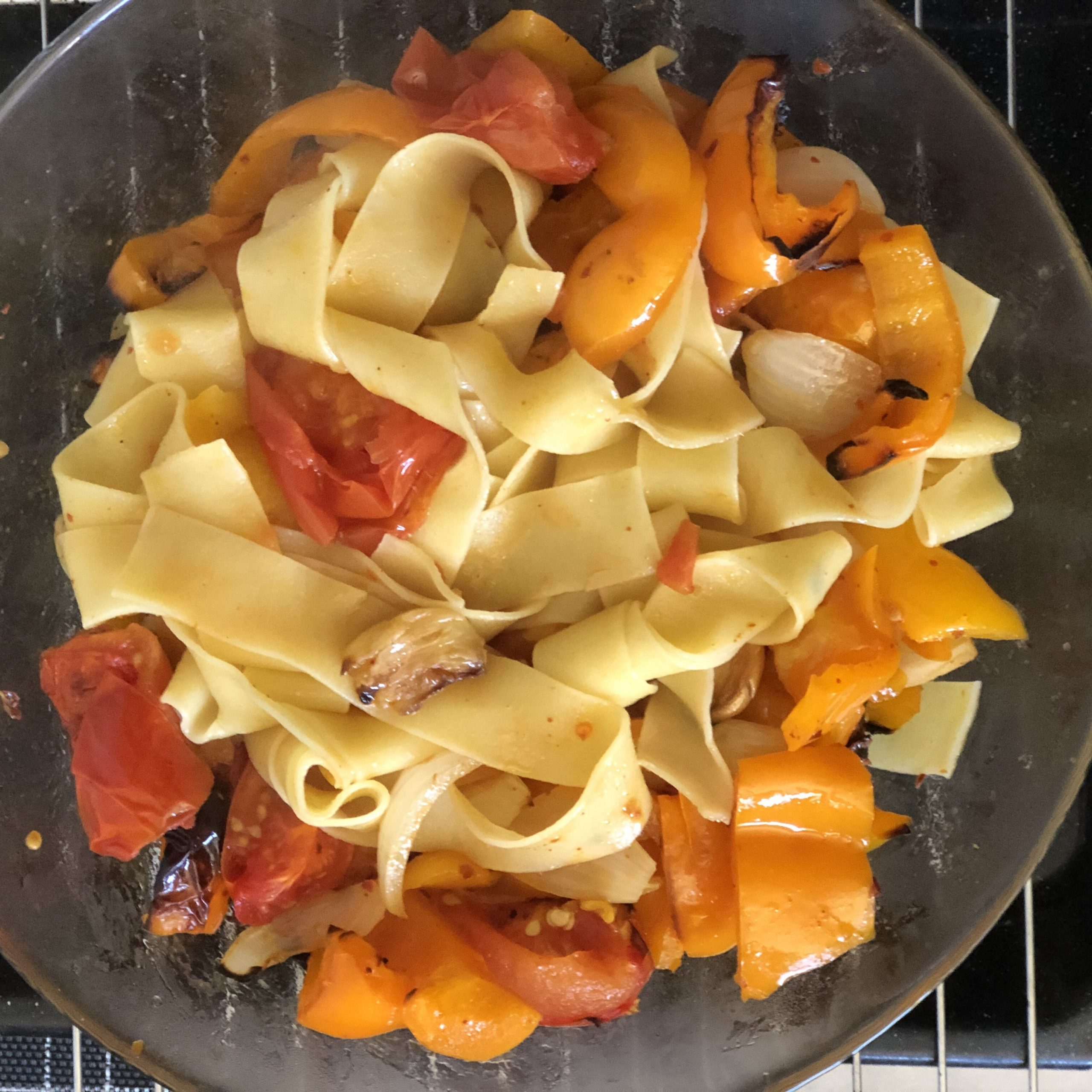 Pappardelle with roasted peppers, tomatoes, onions, chili, garlic and olive oil