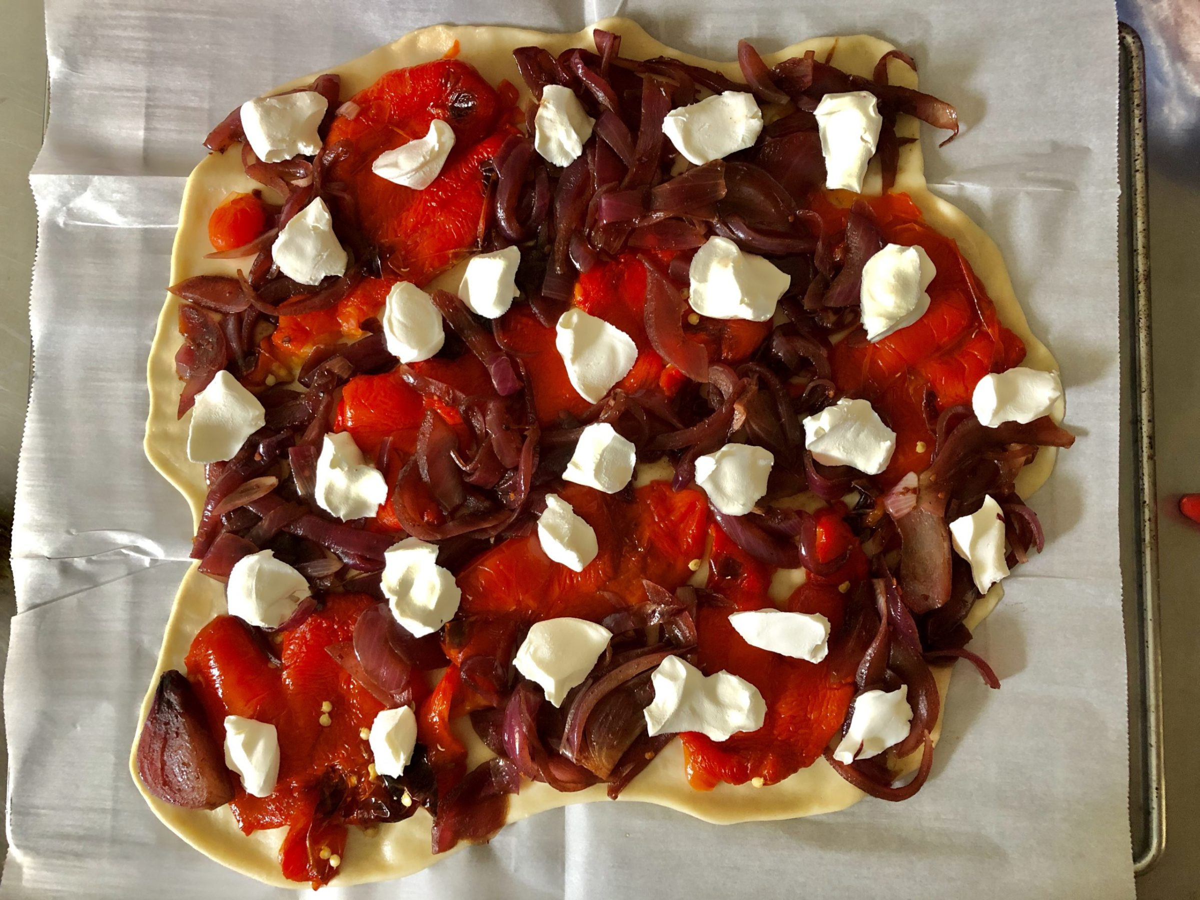 Galette with roasted red peppers, caramelized onions and goat cheese