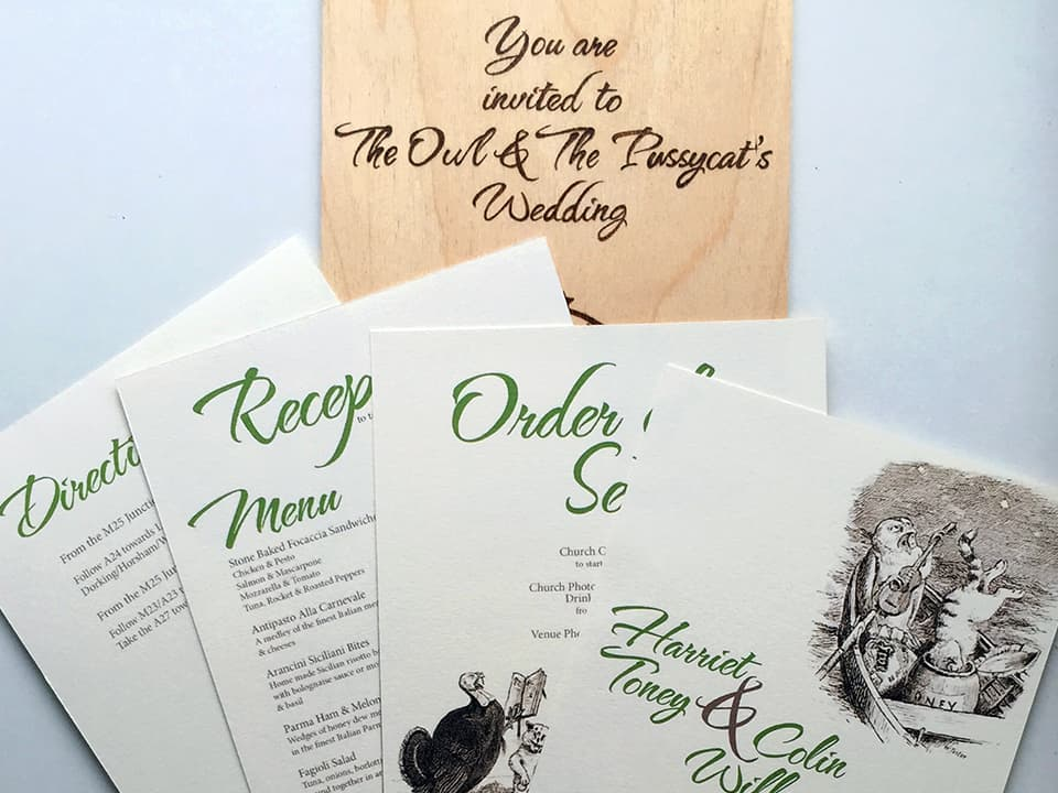 Closeup photo of our wedding stationery. We sent out a wood burning with an owl and pussycat design as a cover with each invitation