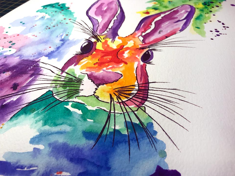 A Creative watercolour painting of a bunny rabbit in rainbow colours