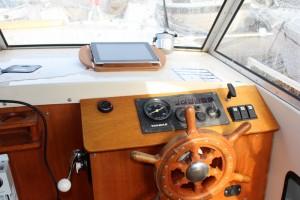 På plass i båten.