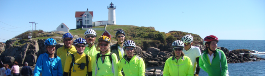 riders loving life in front of lighthouse