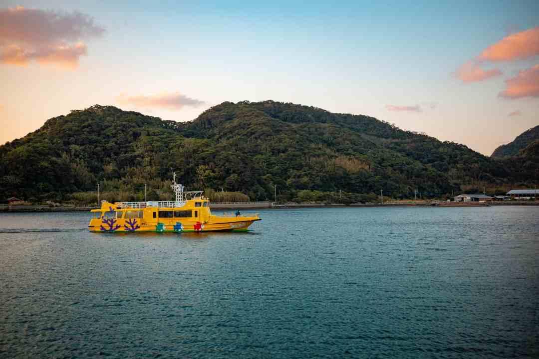ferry boat approaching hisaka island in the goto islands