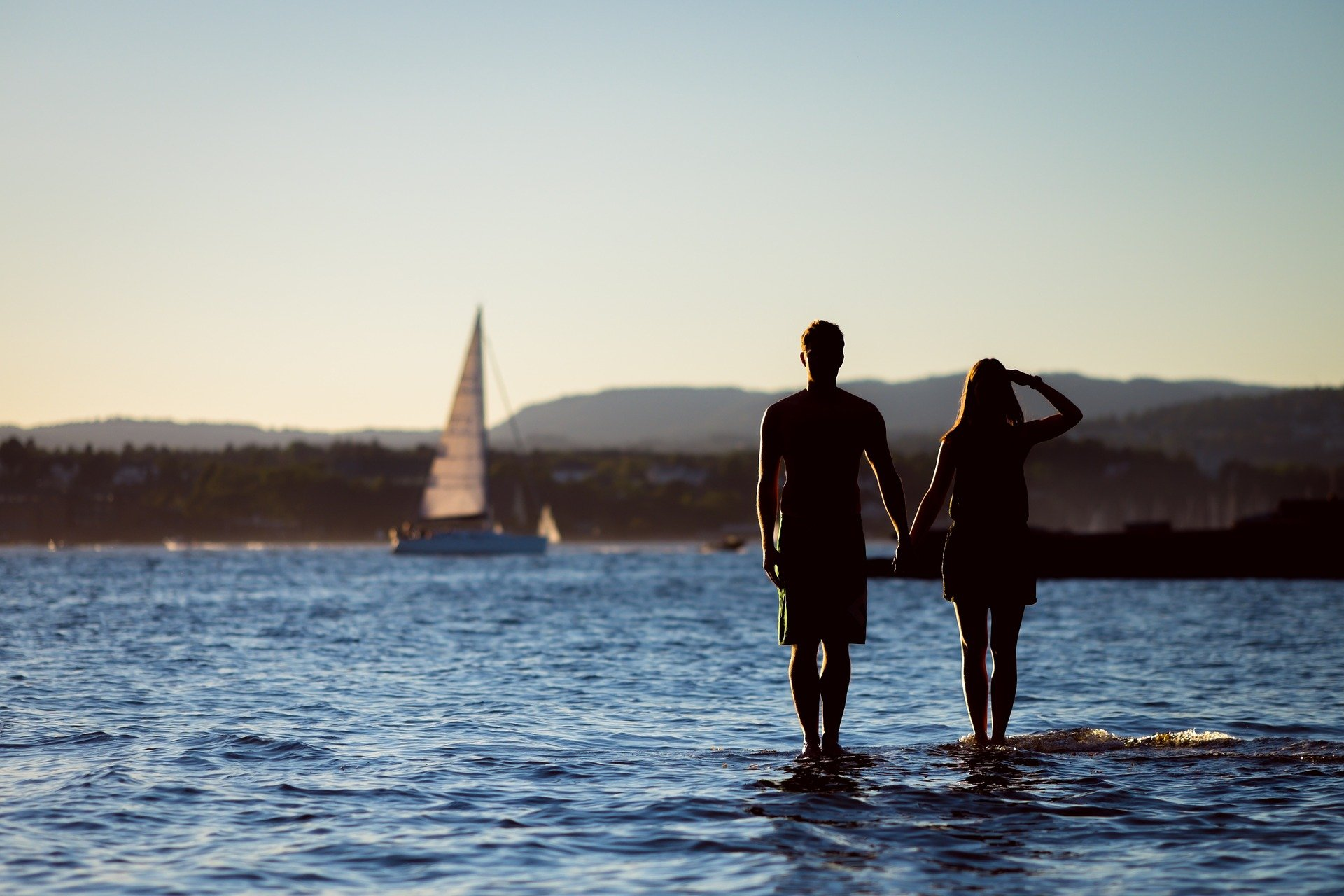 A man and a women standing on water.