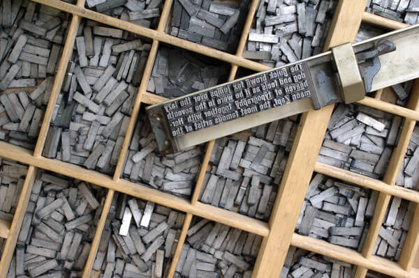 CC-Metal_movable_type-and-composing-stick-by-Willi-Heidelbach