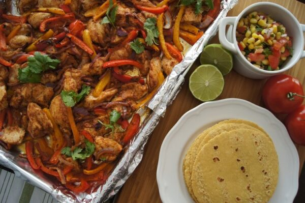 17 Easy Sheet Pan Dinners for Busy Nights (Sheet Pan Chili and Lime Chicken Fajitas with Corn and Cilantro Salsa from Messy Little Kitchen)