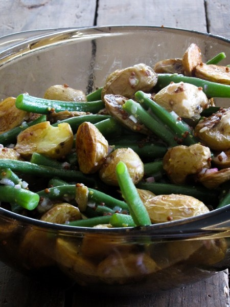 A warm roasted baby potato salad with juicy green beans, tossed in a simple mustard vinaigrette. It's mayo-free and perfect for summertime parties!