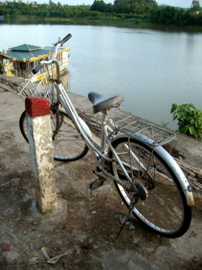 Bicycle by the perfume river. Photo Nadia Krige