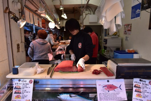 Cutting the fresh tuna for sashimi