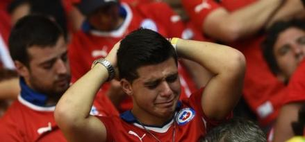 A Chile's fan reacts after losing their 2014 World Cup round of 16 game against Brazil  at the Mineirao stadium in Belo Horizonte