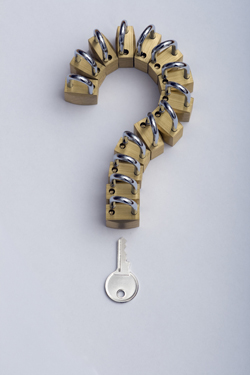 Question mark made by padlocks and a key
