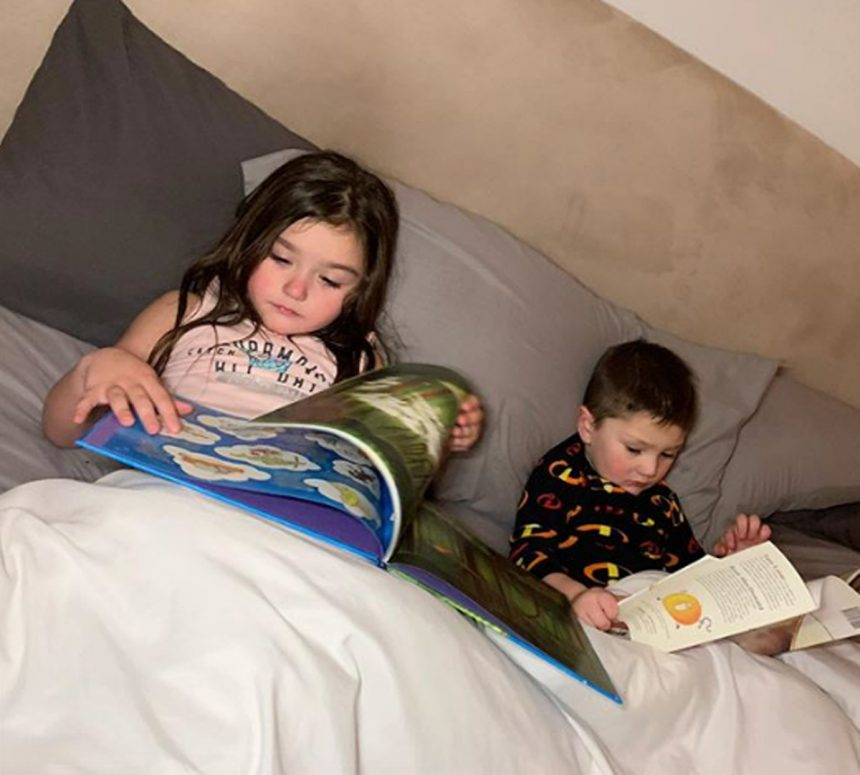 JWoww Greyson Meilani reading in bed