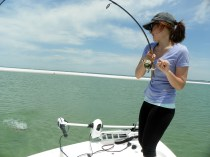 Madie fighting a Cape San Blas Redfish