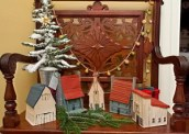 Vintage Christmas Houses and an old flocked tree on an antique chair