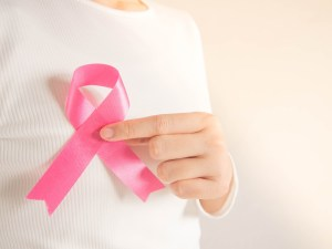 woman holding breast cancer ribbon