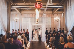 The Foundry by Herban Feast wedding in Seattle | Mid-century modern ceremony with breeze-way backdrop | Perfectly Posh Events | Carina Skrobecki Photography | Vintage Ambiance